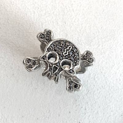 FLAT PAVE SKULL-CROSSED BONES RING